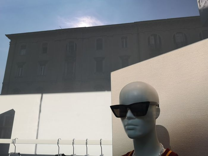 Low angle view of sunglasses on building against sky