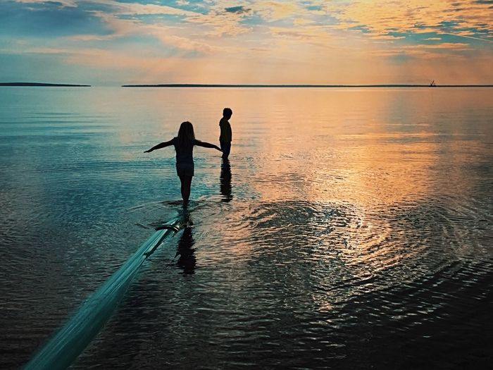 Amazing Sky Boy And Girl Brother And Sister Kids Playing Outside No Screentime Kids Playing Beach Water Sea Two People Nature Leisure Activity Horizon Over Water Real People Scenics Silhouette Sunset Rippled Waterfront Balance Standing Sky Lifestyles
