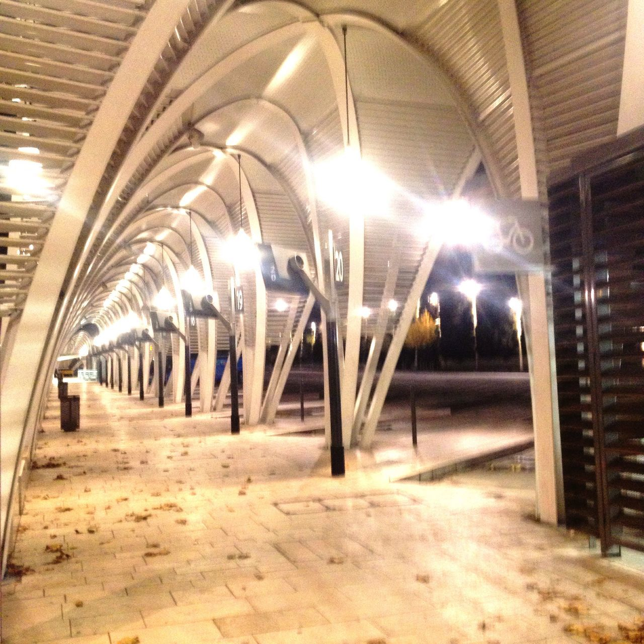 illuminated, indoors, ceiling, empty, the way forward, lighting equipment, arch, architecture, tunnel, no people, night