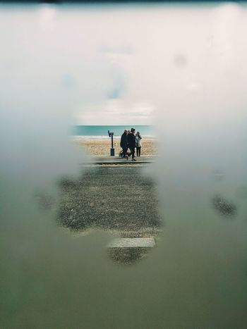 Peeking Through Window Frame Horizon Over Water Beach Beauty In Nature People Photography People Watching Less Is More People With A Story Staring Contest Love ♥ HuaweiP9