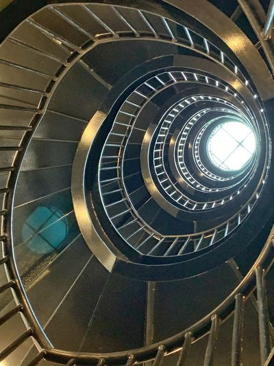 Directly below shot of spiral staircase of building
