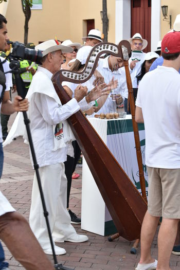 Arpa Day Harp Men Musician Outdoors People Performance Playing Real People Standing