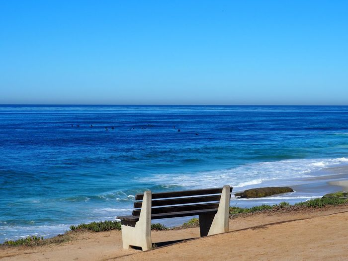 Sea Water Sky Horizon Over Water Beach Land Horizon Scenics - Nature Beauty In Nature Blue Tranquility Tranquil Scene Clear Sky Nature Copy Space Idyllic Seat Day No People Outdoors Bench Tranquility Loneliness Minimalism Empty