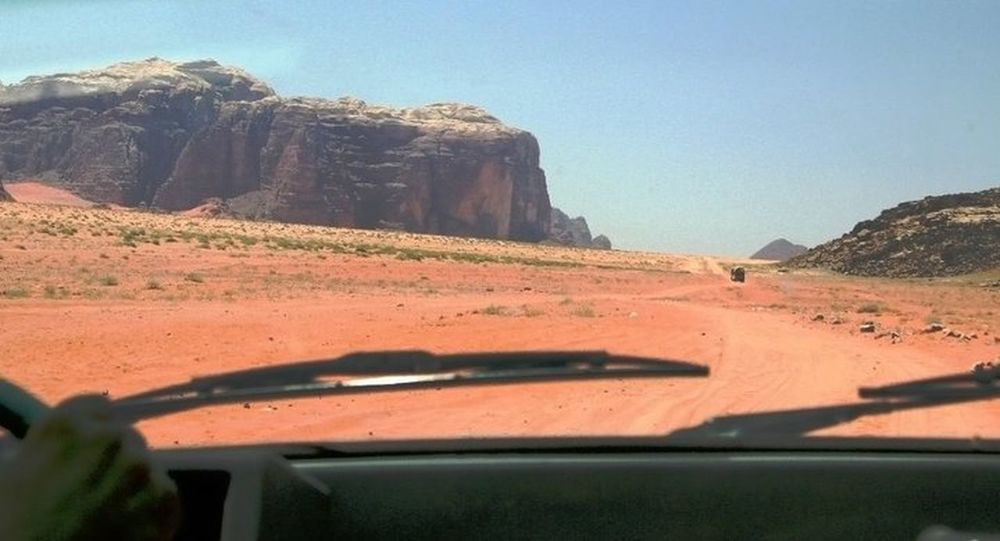 Car Transportation Travel Sunlight Land Vehicle Day Nature No People Sky Outdoors Beauty In Nature Desert Desert Road Desert Rock Desertroad Desertrock Fromcar EyeEmNewHere EyeEm Nature Lover Jordan Wadi Rum