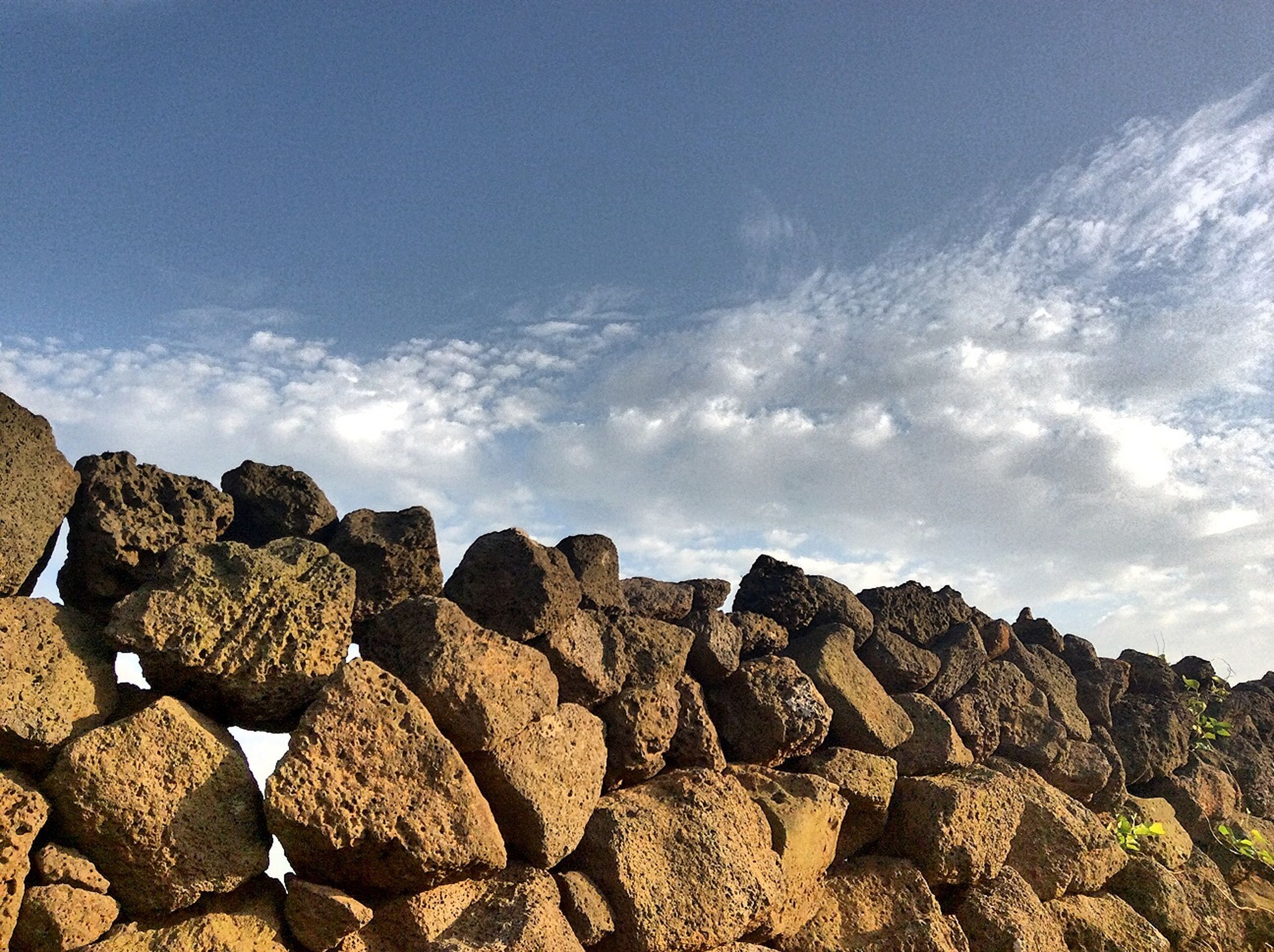 rock - object, sky, water, cloud - sky, tranquility, scenics, rock formation, tranquil scene, nature, beauty in nature, cloud, rock, stone - object, sea, day, outdoors, cloudy, idyllic, stone, reflection