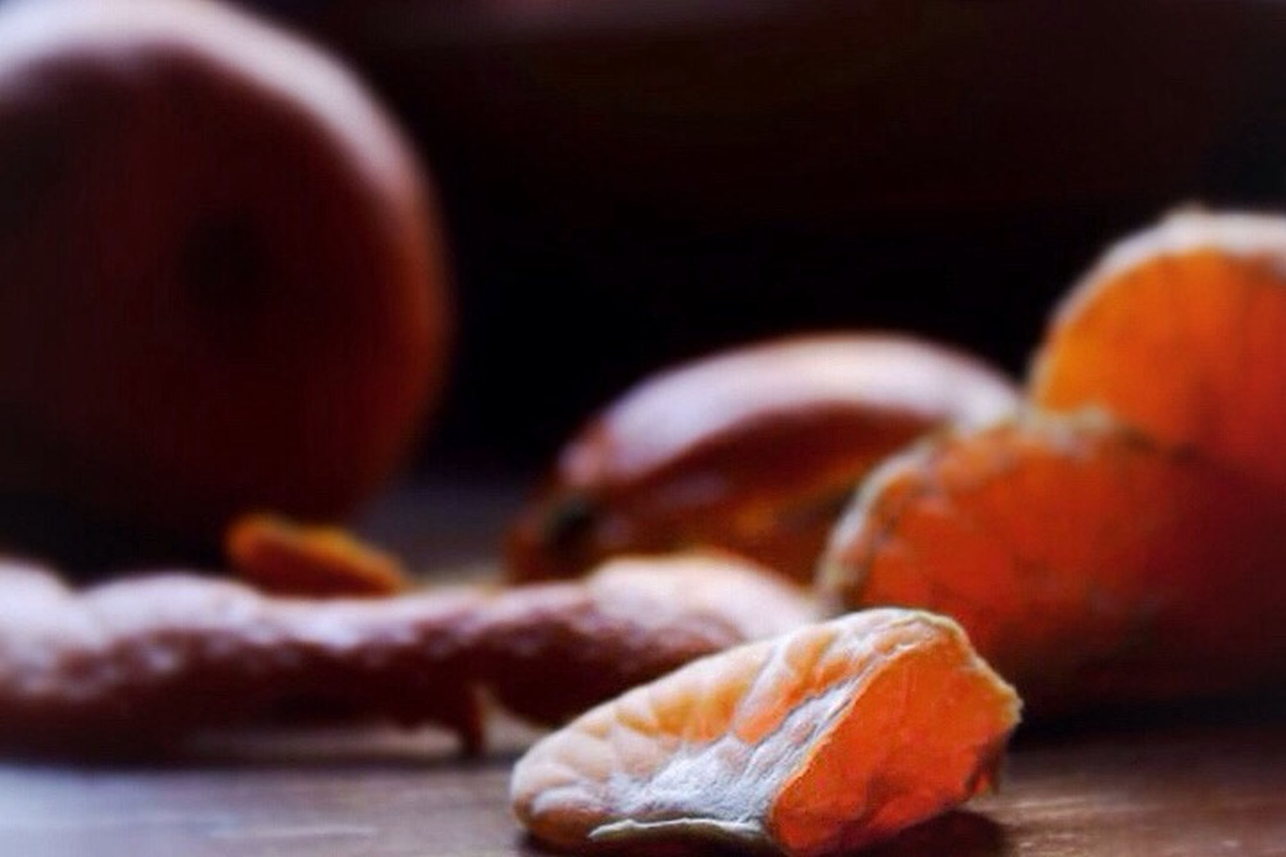 close-up, selective focus, focus on foreground, still life, table, orange color, indoors, food and drink, no people, freshness, healthy eating, food, brown, wood - material, red, day, detail, vegetable, surface level