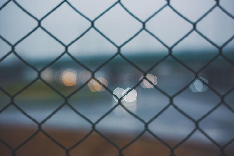 Full frame shot of chainlink fence against sky