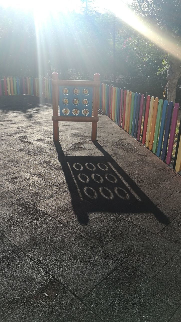 VIEW OF TEXT ON FOOTPATH AT PARK