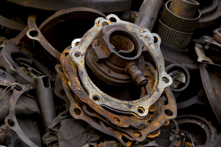 Old dirty gasket is dumped. Old Dirty Gasket Abandoned Car Close-up Complexity Damaged Day Decline Deterioration Equipment Gasket Gaskets Changed Iron - Metal Junkyard Machine Part Machinery Metal Mode Of Transportation Motor Vehicle No People Obsolete Run-down Rusty Still Life Transportation
