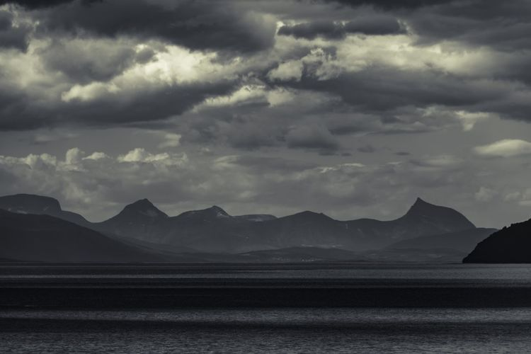 explore the coastline Cloud - Sky Sky Scenics - Nature Beauty In Nature Water Tranquility Tranquil Scene Mountain No People Sea Nature Land Beach Non-urban Scene Day Idyllic Sand Outdoors Blackandwhite EyeEm Nature Lover Exceptional Photographs Landscape_Collection Betterlandscapes Nature Scenery Landscape_photography Monochrome Lofoten Islands Norway Dramatic Sky The Great Outdoors - 2019 EyeEm Awards The Creative - 2019 EyeEm Awards