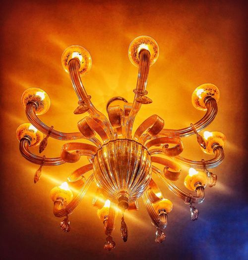 Chandelier Interior Design Lighting Equipment Light - Natural Phenomenon Art And Craft Celebration Orange Color Creativity Indoors  Chandelier Close-up Light Low Angle View Electric Light Lighting Equipment Glowing Illuminated Gold Colored Nature No People Decoration Pattern Ceiling