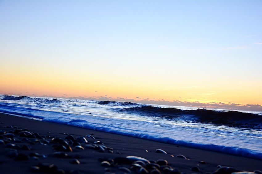Stones Outdoors Wave Sea Nature Sunset Beauty In Nature Tranquility Horizon Over Water Tranquil Scene No People Sand Water Beach Traveling Home For The Holidays