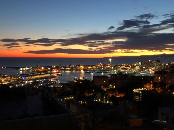 Dusk in Genoa Sky Water Illuminated Sea Sunset Cloud - Sky Nature No People Architecture City Scenics - Nature Beauty In Nature Dusk Transportation Built Structure Nautical Vessel Night Building Exterior Outdoors Cityscape