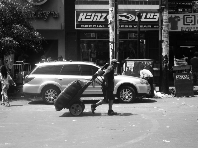 Frank (Lima, feb 2017) Gamarra Streetphotography Steeetphotography Peru Lima Monochrome Blackandwhite Black And White Walking City City Life Urban Urban Landscape Summer People One Person City Text Outdoors Day Working Working Hard Sunny Land Vehicle Crowded