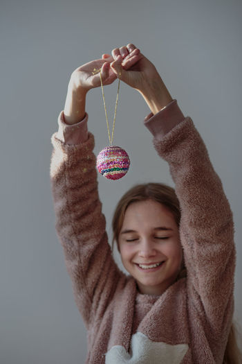 Girl Holding Christmas Bauble