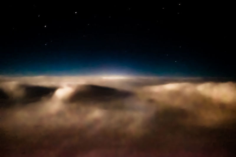 The clouds illuminated by the full moon, the stars bright in the dark velvet sky. Air Transportation Air Travel  Altitude Beauty In Nature Cloud Cloud Deck Clouds And Sky Dark Idyllic Majestic Moonlight Moonshine Nature Night Outdoors Redeye Scenics Sky Skyscape Stars Tranquil Scene Tranquility