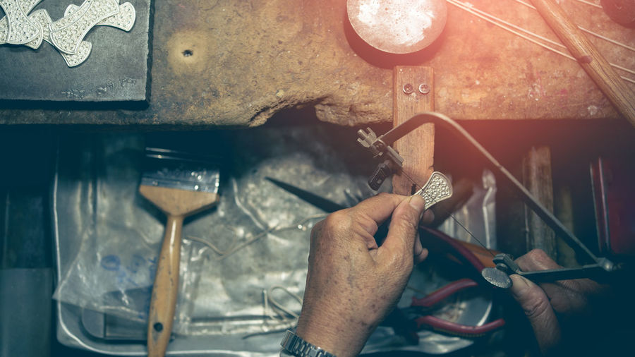Midsection of man working in machine