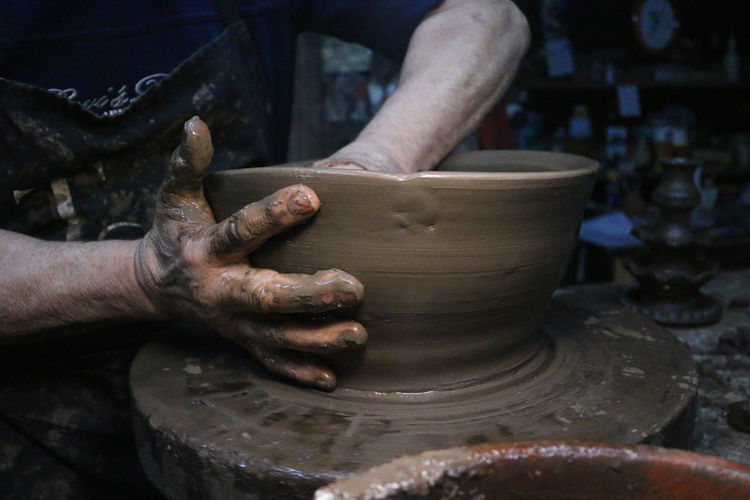 Potter Art And Craft Clay Craft Creativity Expertise Finger Hand Human Body Part Human Hand Making Men Messy Molding A Shape Mud Occupation One Person Pottery Pottery Art Preparation  Real People Skill  Spinning Working Workshop