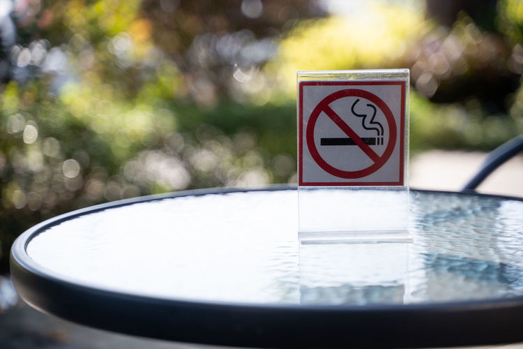 Cigarette  Close-up Communication Crockery Day Focus On Foreground Forbidden Human Representation Nature No People No Smoking Sign Outdoors Reflection Representation Selective Focus Shape Sign Still Life Warning Sign Water