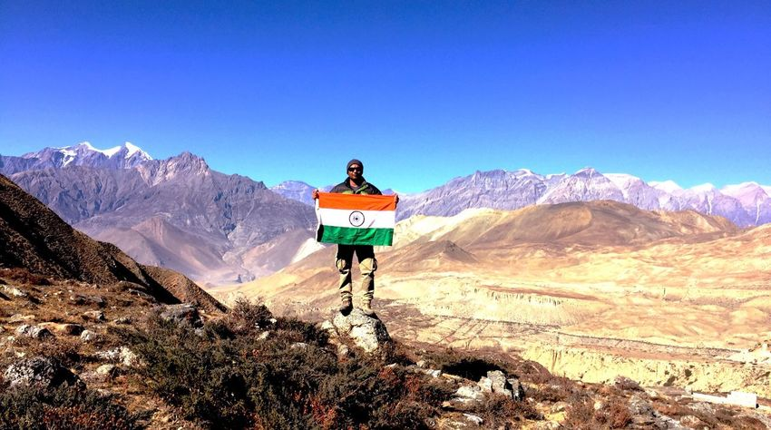 Mountain Adventure Mountain Range One Person Landscape Full Length Nature Looking At View Travel Beauty In Nature Outdoors Challenge Freedom Tranquil Scene Leisure Activity Non-urban Scene Day Scenics Front View Travel Destinations With Indian Flag Cold Temperature Most Beautiful Place On Earth❤