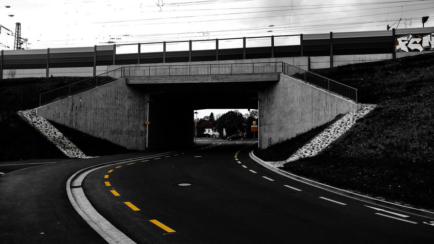 Dark Road, part 2 Road Marking Road Transportation Connection The Way Forward Bridge - Man Made Structure Day Outdoors Built Structure No People Road Sign Architecture Parking Garage Sky Tranquility Kitzingen City Nocars Nopeople Bridge Railing Paint The Town Yellow