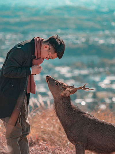 Nice to meet you! Deer Moments Deersighting Deer Nara,Japan Autumn Autumn🍁🍁🍁 Mt Wakakusa Portrait Portrait Photography Portraits The Modern Professional Men Water Side View Sky