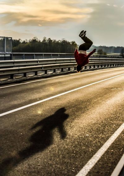 shadow One Person Real People Sunset Full Length Sky Lifestyles Road Street Outdoors Leisure Activity Transportation Sunlight Jumping Day Men Standing Land Vehicle Human Body Part Motion Dancer Parkour Prekmurje Slovenia Architecture Athlete