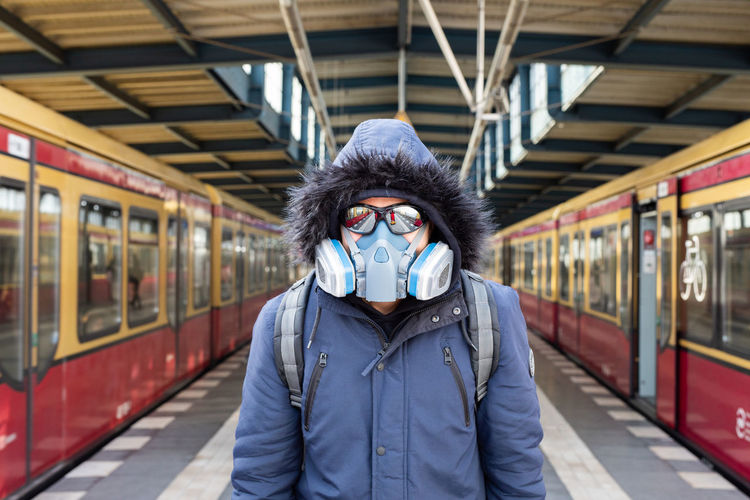 Portrait of man with mask  at railroad station