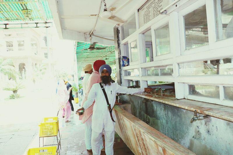 This person gives free service in gurudwara to serve cold water to pilgrims. Satguru ki sewa safal hai. Adult People Water Outdoors Summers Neighborhood Map Ludhiana Punjabi GurudwaraSahib BYOPaper! The Great Outdoors - 2017 EyeEm Awards Live For The Story Travel Destinations Drinking Glass Spirituality The Street Photographer - 2017 EyeEm Awards Working Real People Looking At Camera The Portraitist - 2017 EyeEm Awards The Photojournalist - 2017 EyeEm Awards