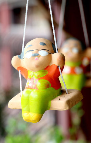 Hanging Focus On Foreground Close-up No People Food And Drink Fruit Drink Day Freshness Indoors  Colorful Color Ceramic Ceramic Doll Clay Doll Doll Swing Baked Clay Happy Happiness Relax Health Simple Backgrounds Toy