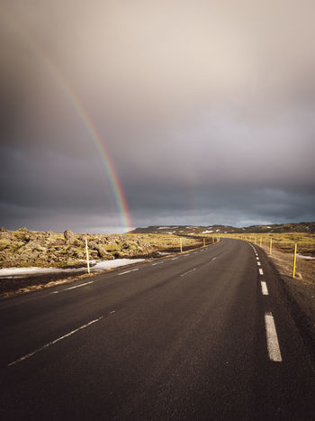 rainbow over road against sky Copy Space Iceland Iceland Memories Mountain View Nature Photography Nordic Light Stormy Weather Travel Photography Beauty In Nature Cloud - Sky Direction Double Rainbow Environment Iceland Trip Idyllic Landscape Mountain Range Nature No People Nordic Nordic Winter Outdoor Photography Outdoors Philipp Dase Rain Rainbow Road Scenics - Nature Sign Sky Stormy Sky Street Symbol The Way Forward Tranquil Scene Tranquility Transportation