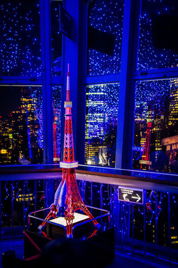 A model of the Tokyo Tower Tokyo Tokyo Tower Amusement Park Amusement Park Ride Architecture Arts Culture And Entertainment Blue Carousel Christmas Christmas Decoration Illuminated Indoors  Lighting Equipment Model Night No People