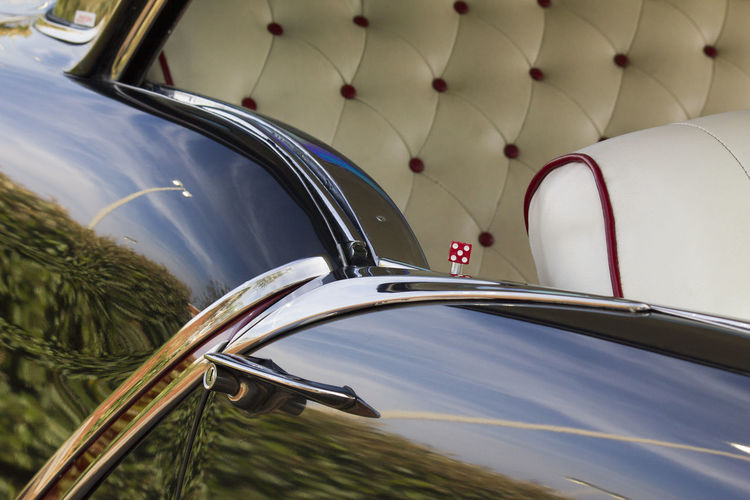 Cropped Image Of Vintage Car With Reflection