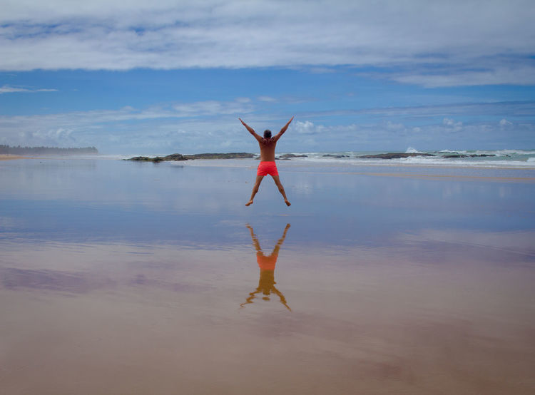 Yes Arms Raised Beach Beauty In Nature Cloud - Sky Day Energetic Full Length Handstand  Leisure Activity Nature One Person Outdoors Real People Rear View Sea Sky Upside Down Water Women