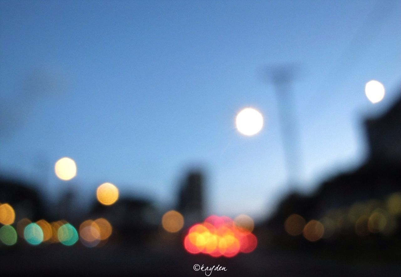 illuminated, night, moon, lens flare, defocused, no people, outdoors, close-up, clear sky, sky, city, nature
