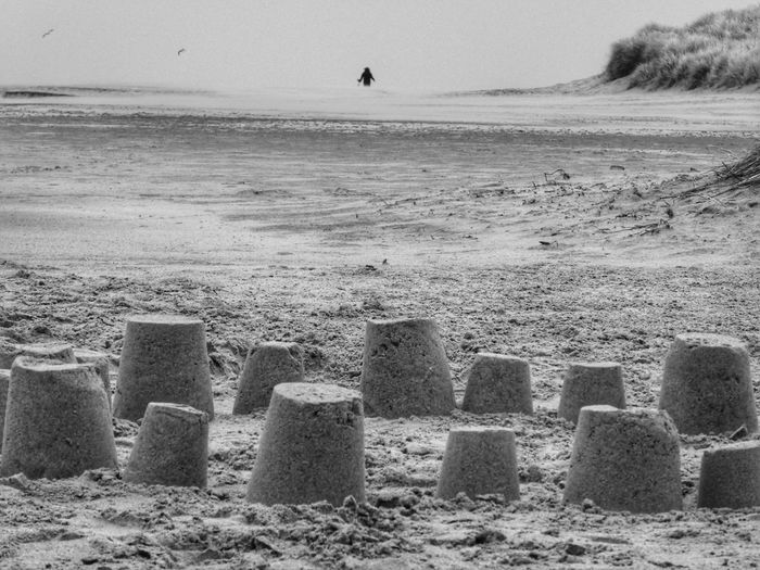 Sandcastles Child Beach Photography Blackandwhite Photography Scotland Scotlandsbeauty Isle Of Lewis WeatherPro: Your Perfect Weather Shot Land Beach Sand Sea Nature Scenics - Nature Day Water Sky Beauty In Nature Tranquility Tranquil Scene Sunlight Incidental People Horizon Outdoors Sandcastle Horizon Over Water