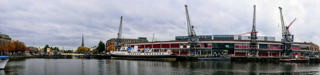 harbor Photowalktheworld EyeEm Selects Water Nautical Vessel City Industry Sea Commercial Dock Business Finance And Industry Harbor Sky Architecture Shipyard Tall Ship Barge Rigging Cargo Container Crane - Construction Machinery Panoramic Container Ship Shipping  Industrial Ship Ship's Bow Anchor - Vessel Part