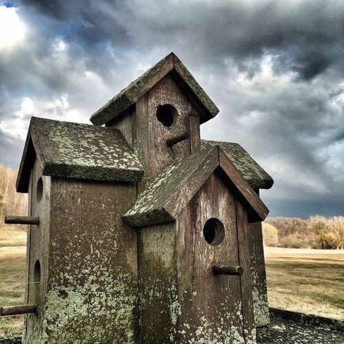 Exterior of church against cloudy sky