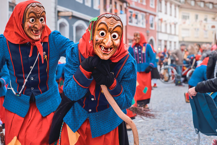 Portrait of people on street in city
