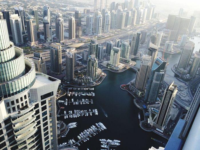 Aerial view of modern city buildings by sea