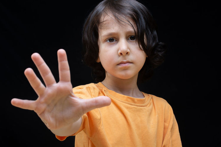 No Background Boy Caucasian Child Childhood Cute Denial Discrimination Expression Face Forbidden Gesture Gesturing Girl Hand Human Isolated Kid Little One Palm People person Portrait Prohibition Refusal Serious Showing Sign Stop Studio Violence Warning White Young