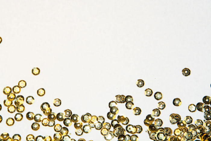 golden round sequins sewing on a white background Abstract Background Bright Brilliant Circle Clothing Crafts Decoration Design Disco Dots Elegant Fashion Glamour Glitter Gold Golden Isolated Luxury Metallic Round Sequins Sewing Shine White Background