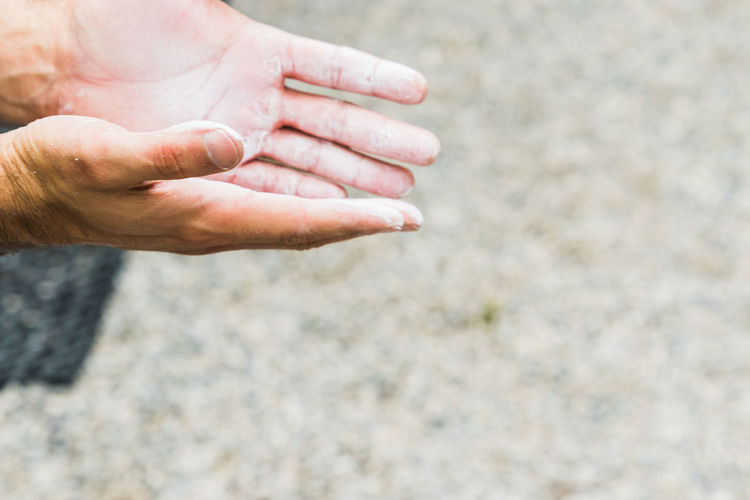 Cropped hands of person begging