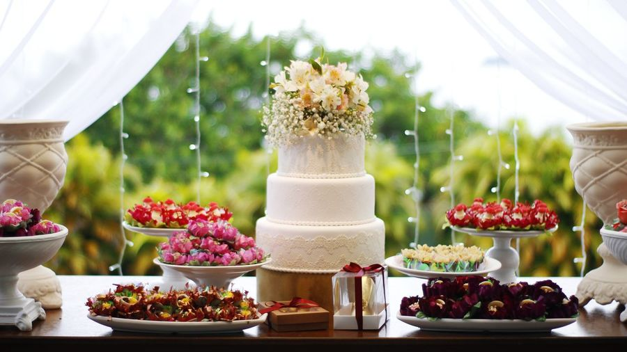 Wedding cake by decoration on table