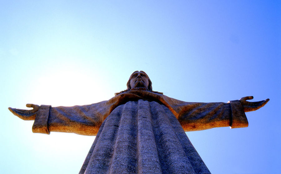 Art Art And Craft Blue Built Structure Christ The King Clear Sky Copy Space Creativity Day Famous Place Human Representation Lisbon - Portugal Low Angle View No People Outdoors Religion Sculpture Sky Spirituality Statue Sunlight