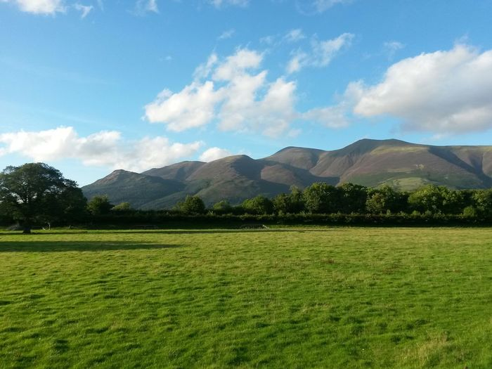 Mountain Cloud - Sky Beauty No People Outdoors Nature Sunlight The Lake District  Green Grass Sun Light Blue Sky, White Clouds