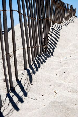 Beach Life Beach Photography Check This Out Life Is A Beach Relaxing Shadows & Lights Sunny The Week On EyeEm Beach Beach Fence Close-up Day Eye4photography  Fence Nature No People Outdoors Sand Sand Dune Sandy Sandy Beach Shadow Shadows Sky Sunlight