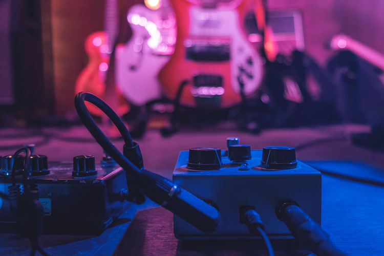 Adjusting Amplifier Button Cable Club Concert Concert Photography Connection Dial Electric Guitar Guitar Illuminated Indoors  Lifestyles Lighting Equipment Music Musical Instrument Nightlife Party - Social Event Rehersal Social Gathering Sound Stage - Performance Space Surface Level Wire