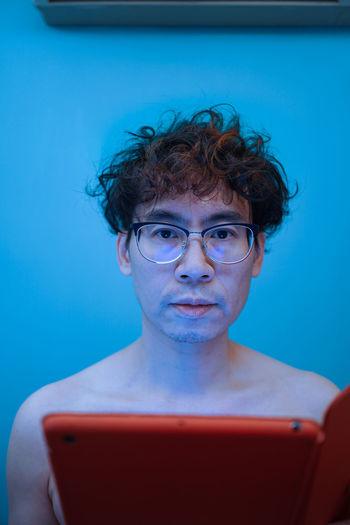 Portrait of mature man using smart phone