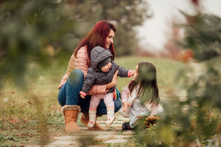 Full length of mother with daughters